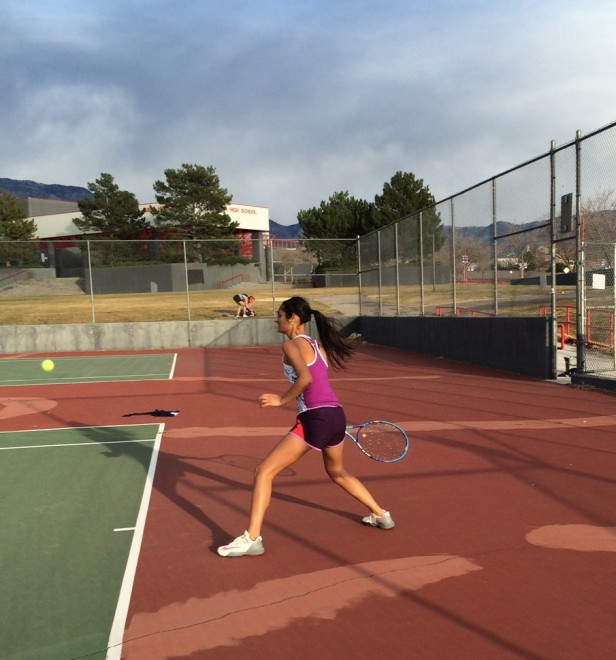 Divya Rajput, junior, Varisty Girls Tennis player, in her stance getting ready to hit a forehand. Photo by Riley Cook
